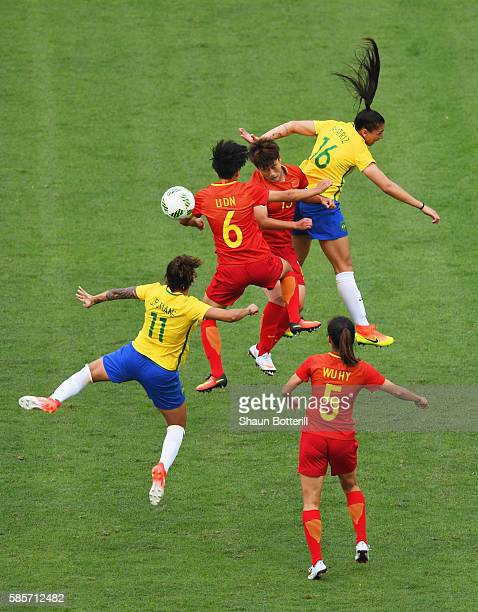 Cristiane and Beatriz of Brazil battle with Dongna Li Haiyan Wu and Fengyue Pang of China during the Women's Group E first round match between Brazil...