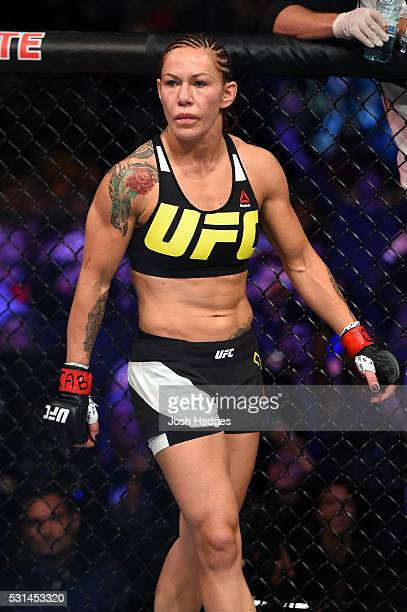 Cristiane 'Cyborg' Justino of Brazil stands in her corner before facing Leslie Smith in their women's catchweight bout during the UFC 198 event at...