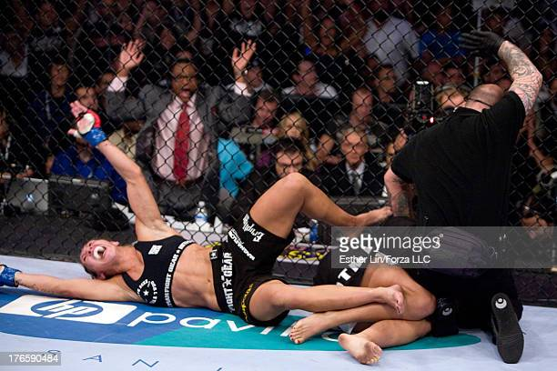 Cristiane 'Cyborg' Santos celebrates after defeating Gina Carano during the inaugural Strikeforce Women's Championship event at HP Pavilion on August...