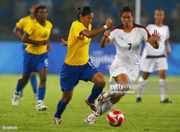 Cristiane of Brazil and Shannon Boxx of United States battle for the ball during the Women's Football Gold Medal match between Brazil and the United...