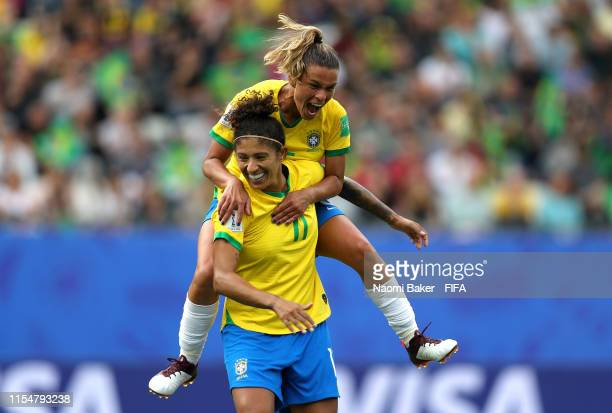 Cristiane of Brazil celebrates after scoring her team's third goal with teammate Tamires during the 2019 FIFA Women's World Cup France group C match...