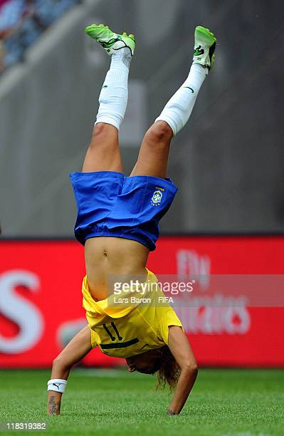Cristiane of Brazil celebrates after scoring his teams second goal during the FIFA Women's World Cup 2011 Group D match between Equatorial Guinea and...