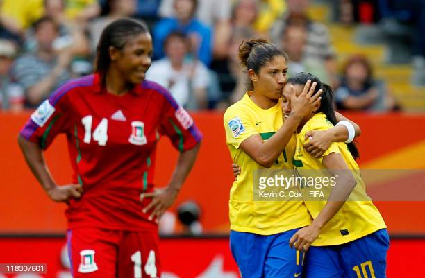 Cristiane of Brazil celebrates her goal against Equatorial Guinea by kissing the forehead of Marta during the FIFA Women's World Cup 2011 Group D...