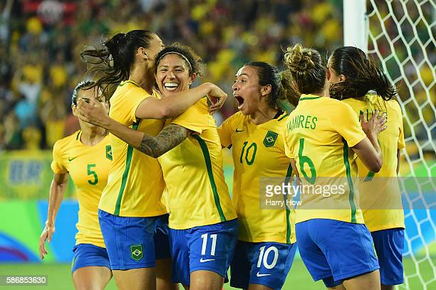 Cristiane of Brazil celebrates her goal with her teammates during the Women's Group E first round match between Brazil and Sweden on Day 1 of the Rio...