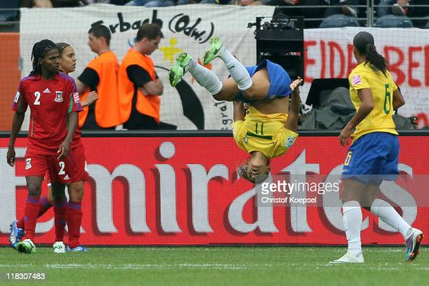 Cristiane of Brazil celebrates the second goal during the FIFA Women's World Cup 2011 Group D match between Equatorial Guinea and Brazil at FIFA...