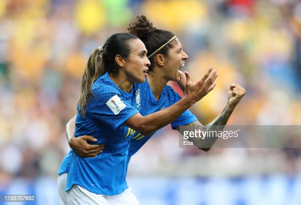 Cristiane of Brazil celebrates with teammate Marta after scoring her team's second goal during the 2019 FIFA Women's World Cup France group C match...
