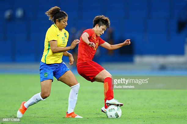 Cristiane of Brazil competes for the ball against Fengyue Pang of China during the Women's Group E first round match between Brazil and China PR...