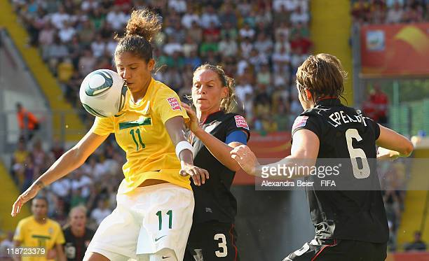 Cristiane of Brazil fights for the ball with Christie Rampone and Amy Le Peilbet of USA during the FIFA Women's World Cup quarter final match between...