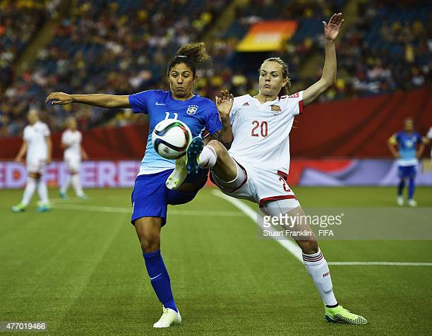 Cristiane of Brazil is challenged by Irene Paredes of Spain during the FIFA Women's World Cup 2015 group E match between Brazil and Spain at Olympic...