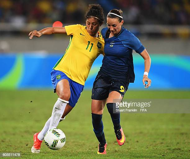 Cristiane of Brazil is challenged by Kosovare Asllani of Sweden during the Olympic Women's Football match between Brazil and Sweden at Olympic...