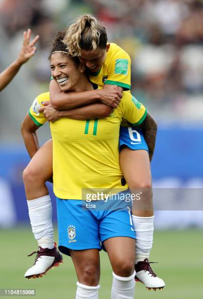 Cristiane of Brazil is congratulated by teammate Tamires after she scored in the second half against Jamaica during the 2019 FIFA Women's World Cup...