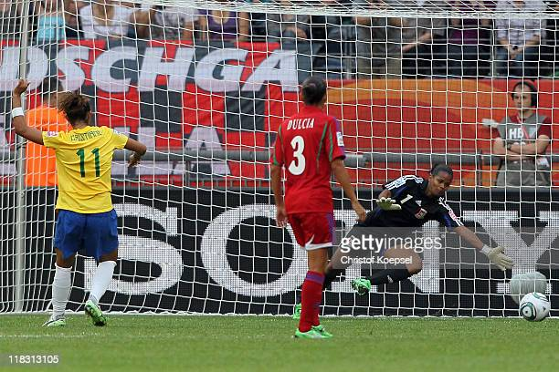 Cristiane of Brazil scores the third goal by penalty against Dulcia of Equatorial Guinea and Miriam of Equatorial Guinea during the FIFA Women's...