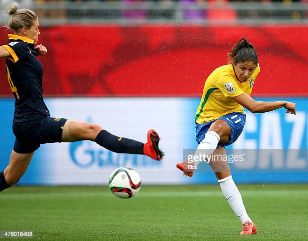 Cristiane of Brazil takes a shot on goal as Alanna Kennedy of Australia defends during the FIFA Women's World Cup 2015 round of 16 match between...