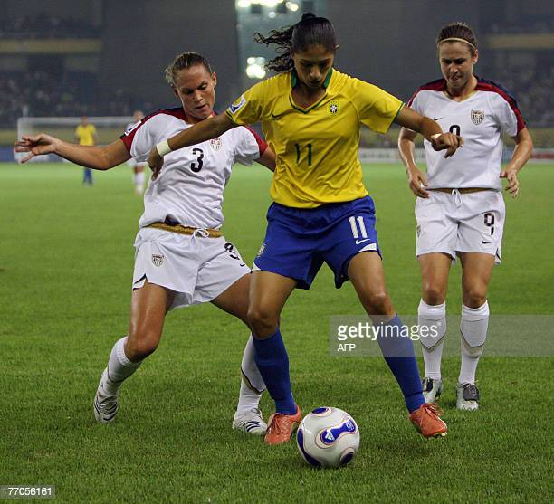 Cristiane of Brazil vie for the ball with Christie Rampone of the US in their semifinal match in the FIFA Women's World Cup football tournament at...