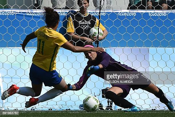 Cristiane of Brazil vies for the ball with goalkeeper Stephanie Labbe of Canada during their Rio 2016 Olympic Games women's bronze medal football...