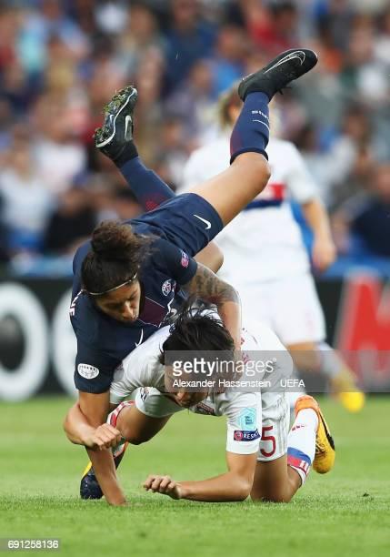 Cristiane of Paris SaintGermain Feminines and Saki Kumagai of Olympique Lyonnais tangle during the UEFA Women's Champions League Final between Lyon...