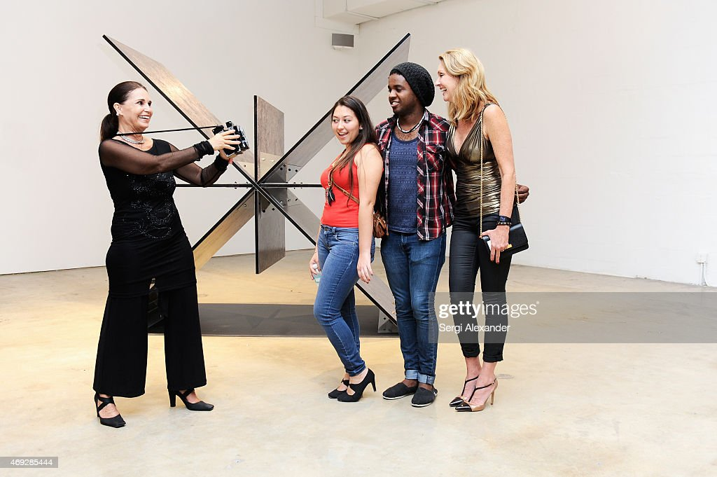 Cristiane Roget, Brian Jean, Veronica Fajardo and Valentina Hubsch attend Andrew Levitas Metalwork Playground opening reception at Blueshift Wynwood on April 10, 2015 in Miami, Florida.