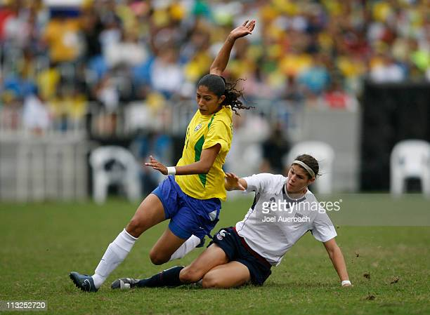 Cristiane Silva of Brazil is taken down by Brittany Taylor of the USA during the women's gold medal match at the 2007 XV Pan American Games on July...