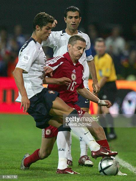 Cristiano Aveiro of Portugal vies with Andrejs Rubins of Latvia in the WC2006 qualification match in Riga 04 September 2004
