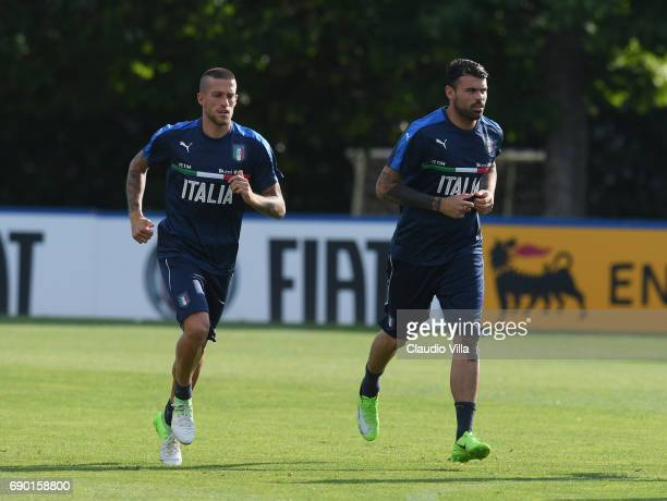 Cristiano Biraghi and Andrea Petagna of Italy in action during the training session at Coverciano at Coverciano on May 30 2017 in Florence Italy