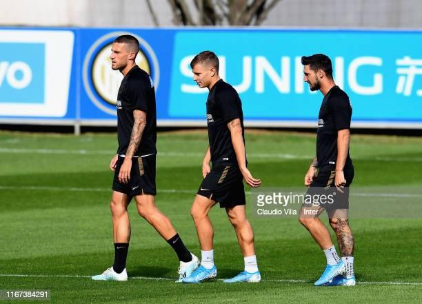Cristiano Biraghi Nicolo Barella and Matteo Politano of FC Internazionale in action during FC Internazionale training session at Appiano Gentile on...