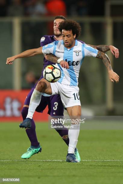 Cristiano Biraghi of ACF Fiorentina battles for the ball with Felipe Anderson of SS Lazio during the serie A match between ACF Fiorentina and SS...