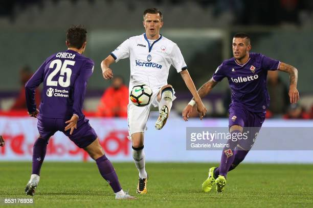 Cristiano Biraghi of ACF Fiorentina battles for the ball with Josip Ilicic of Atalanta BC during the Serie A match between FC Crotone and Benevento...