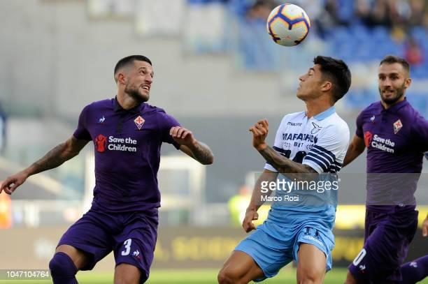Cristiano Biraghi of ACF Fiorentina compete for the ball with Joaquin Correa of SS Lazio during the Serie A match between SS Lazio and ACF Fiorentina...
