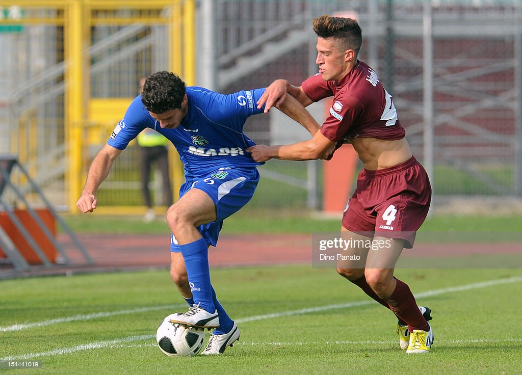 Cristiano Biraghi (R) of AS Cittadella competes with Andrea Catellani of US Sassuolo Calcio during the Serie B match between AS Cittadella and US Sassuolo Calcio at Stadio Pier Cesare Tombolato on October 20, 2012 in Cittadella, Italy.