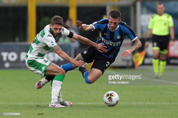 Cristiano Biraghi of FC Internazionale competes for the ball with Domenico Berardi of US Sassuolo during the Serie A match between FC Internazionale...