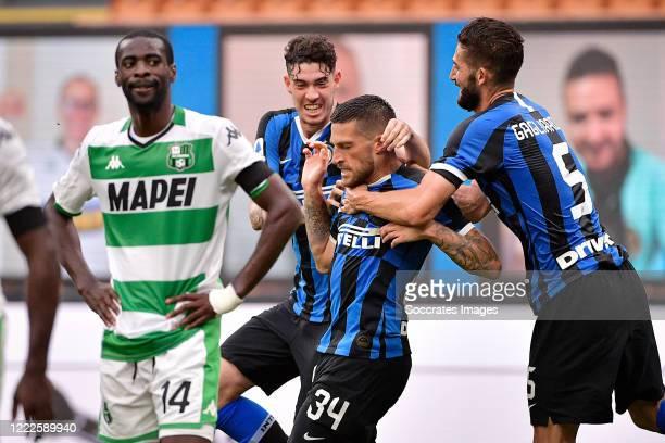 Cristiano Biraghi of Internazionale celebrates 21 with Roberto Gagliardini of Internazionale Alessandro Bastoni of Internazionale during the Italian...