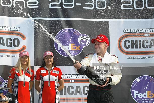 Cristiano da Matta celebrates winning the Grand Prix of Chicago round 7 of the CART FedEx Championship Series on June 30th 2002 at the Chicago Motor...