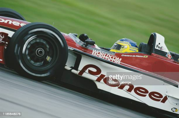 Cristiano da Matta of Brazil drives the PPI Motorsports Pioneer Reynard 2KI Toyota RVA during practice for the Championship Auto Racing Teams 2002...
