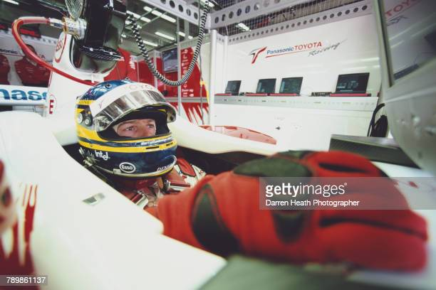 Cristiano da Matta of Brazil sits aboard the Panasonic Toyota Racing Toyota TF104Toyota V10 in the garage during practice for the Formula One...
