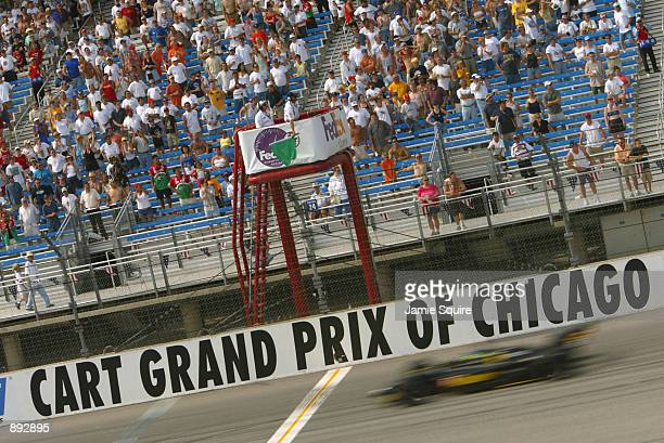 Cristiano da Matta powers across the start finish line during the Grand Prix of Chicago round 7 of the CART FedEx Championship Series on June 30th...