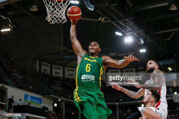 Cristiano Felicio of Brazil dunks the ball against Vincent Poirier of France during the International Friendly match between France and Brazil at The...