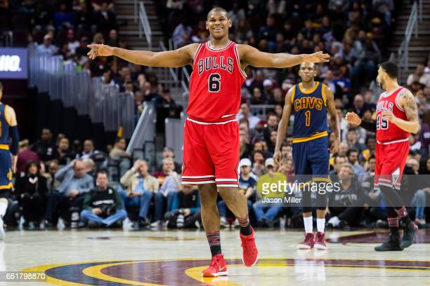 Cristiano Felicio of the Chicago Bulls celebrates after scoring during the second half against the Cleveland Cavaliers at Quicken Loans Arena on...