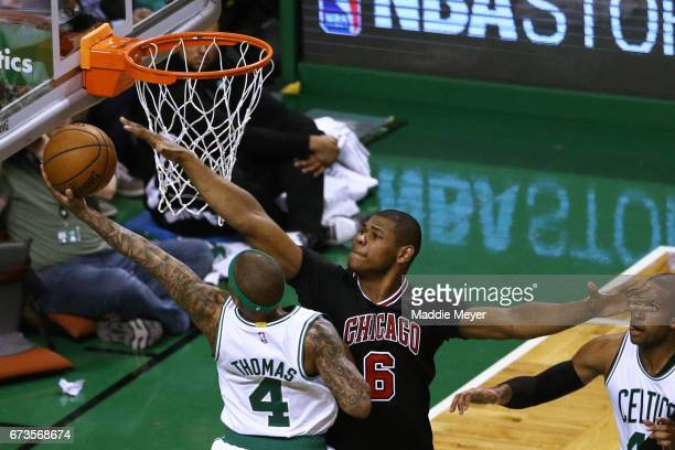 Cristiano Felicio of the Chicago Bulls defends a shot from Isaiah Thomas of the Boston Celtics during the first quarter of Game Five of the Eastern...