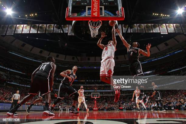 Cristiano Felicio of the Chicago Bulls drives to the basket against the Brooklyn Nets on April 12 2017 at the United Center in Chicago Illinois NOTE...