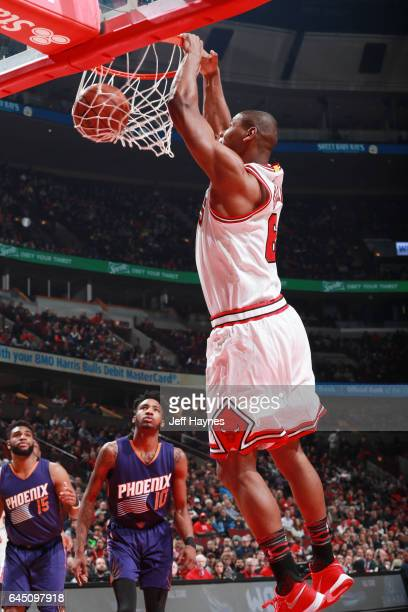 Cristiano Felicio of the Chicago Bulls dunks against the Phoenix Suns during the game on February 24 2017 at the United Center in Chicago Illinois...