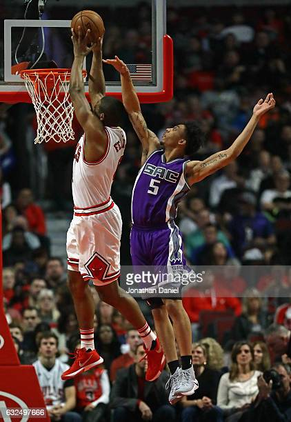 Cristiano Felicio of the Chicago Bulls dunks over Malachi Richardson of the Sacramento Kings at the United Center on January 21 2017 in Chicago...