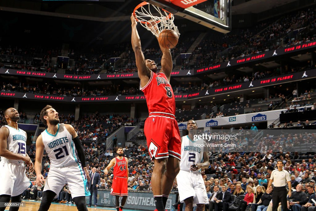 Cristiano Felicio #6 of the Chicago Bulls dunks the ball during the game against the Charlotte Hornets on March 13, 2017 at Time Warner Cable Arena in Charlotte, North Carolina.