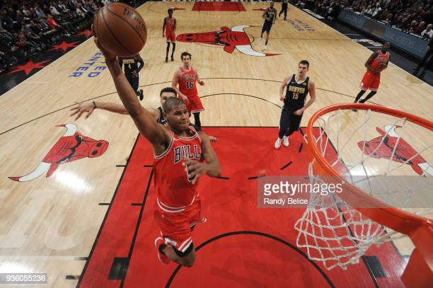 Cristiano Felicio of the Chicago Bulls dunks the ball during the game against the Denver Nuggets on March 21 2018 at the United Center in Chicago...