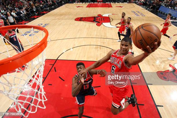 Cristiano Felicio of the Chicago Bulls goes to the basket against the Washington Wizards on March 20 2019 at the United Center in Chicago Illinois...