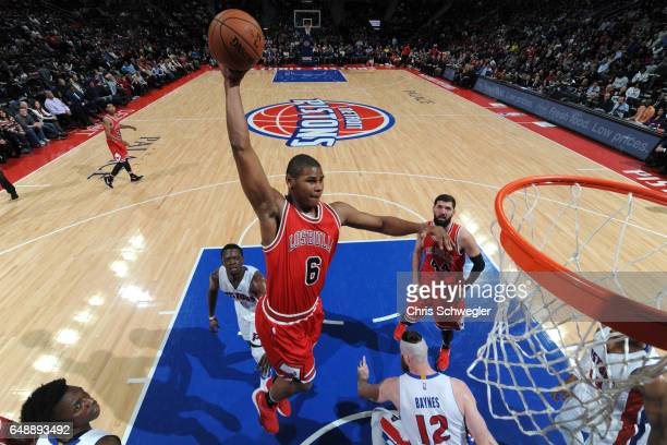Cristiano Felicio of the Chicago Bulls goes up for a dunk against the Detroit Pistons on March 6 2017 at The Palace of Auburn Hills in Auburn Hills...