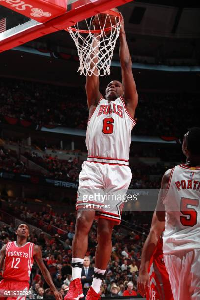 Cristiano Felicio of the Chicago Bulls goes up for a dunk against the Houston Rockets on March 10 2017 at the United Center in Chicago Illinois NOTE...