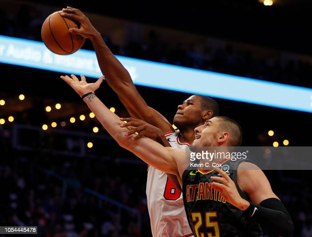 Cristiano Felicio of the Chicago Bulls grabs a rebound against Alex Len of the Atlanta Hawks at State Farm Arena on October 27 2018 in Atlanta...