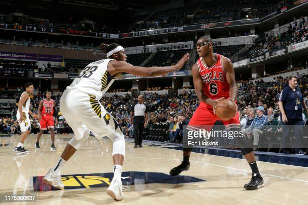 Cristiano Felicio of the Chicago Bulls handles the ball against the Indiana Pacers during a preseason game on October 11 2019 at Bankers Life...
