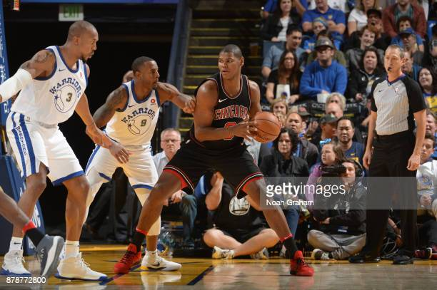 Cristiano Felicio of the Chicago Bulls handles the ball against the Golden State Warriors on November 24 2017 at ORACLE Arena in Oakland California...