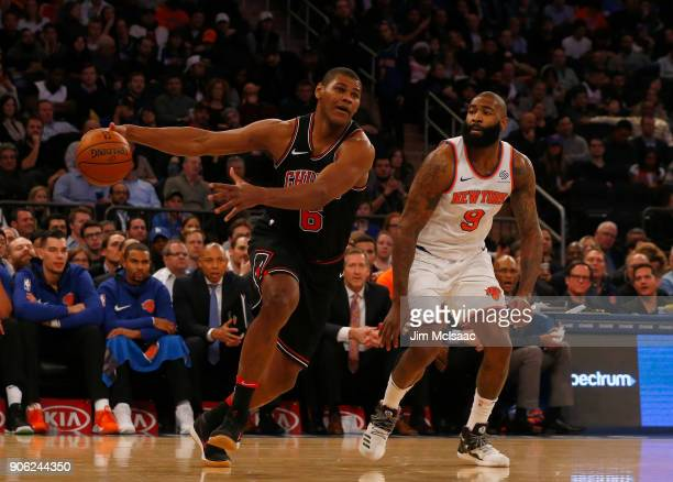 Cristiano Felicio of the Chicago Bulls in action against Kyle O'Quinn of the New York Knicks at Madison Square Garden on January 10 2018 in New York...